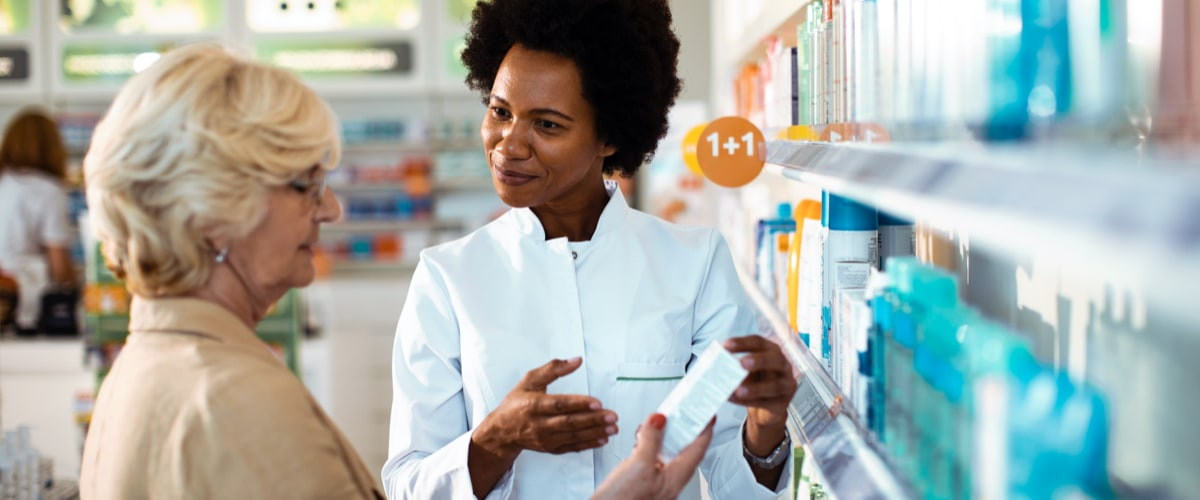 Close up of a senior lady consulting with her pharmacist