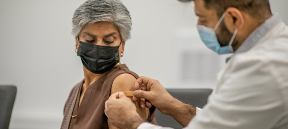 woman receiving a covid vaccine