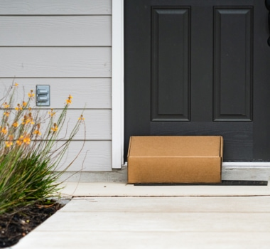 Cardboard Box left on doormat of front door