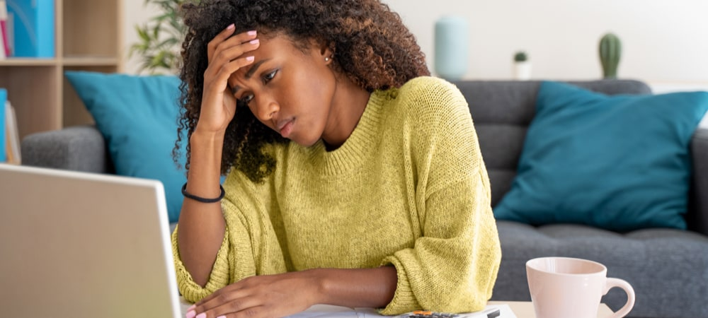 Stressed woman working at home alone